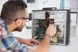 Computer engineer working on broken console in his office